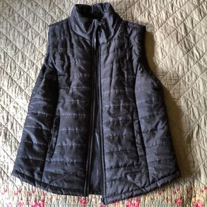 Black puffy vest with pockets
